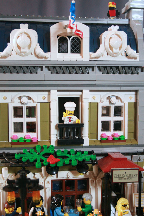 The chef greeted adoring fans from his balcony. Note seashells and croissants as architectural details.