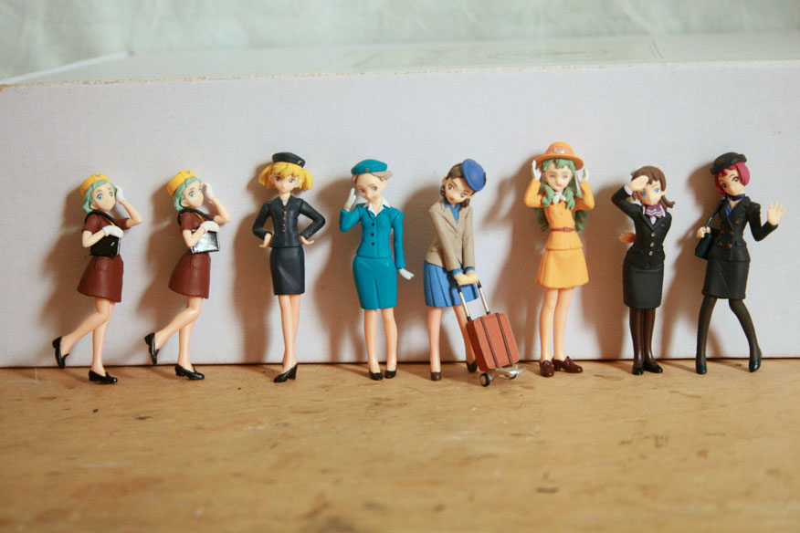 Here are the figures that I acquired. Each stands 6cm high. They all came with stands [not shown], but several of them can balance without the stands, adding to their realism as dolls.