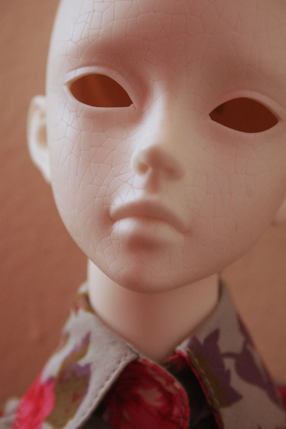 "Fritillaria came with two heads, one regular and this one, called the ""cracked head."" That's because there's crazing sculpted into her face, as if her paint is chipping! It was this detail that convinced me to get her and make her my runaway marionette/jester of death/clown doll."
