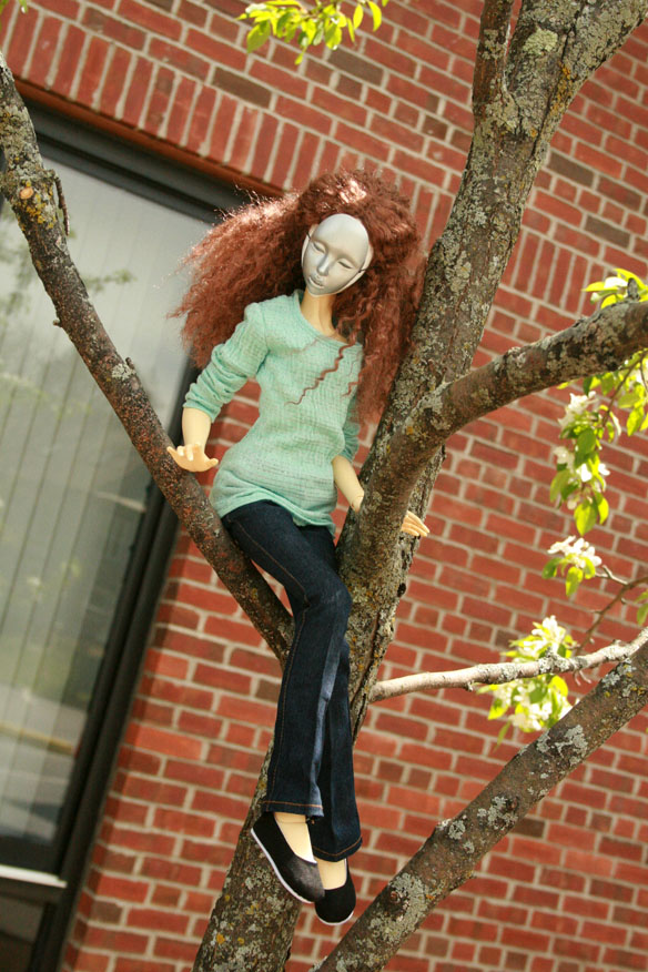 Dolls tend to look good in trees if you can get 'em to balance...